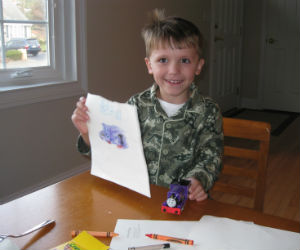 Adam is very proud of his Charlie Thomas train coloring page