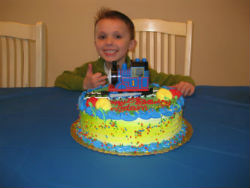 Adam approves of his Thomas train birthday cake