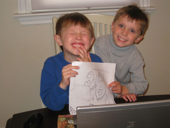 Charles and Adam proudly displaying their coloring page