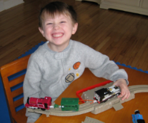 Charles proudly repaired his TrackMaster trains with Bendaroos