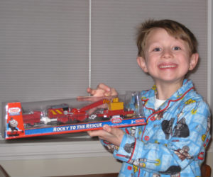Charles showing off his new trackmaster Rocky the crane