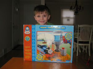 Adam proudly opening his Thomas steam set