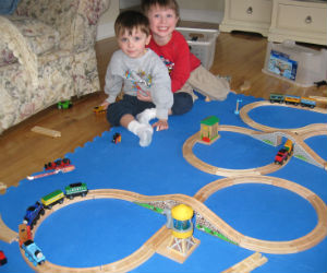 Charles and Adam wooden railway trains