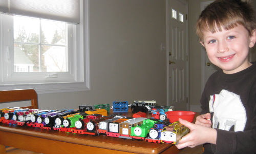 Charles with his TOMY collection of battery operated trains