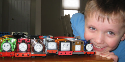 Adam with his Trackmaster trains